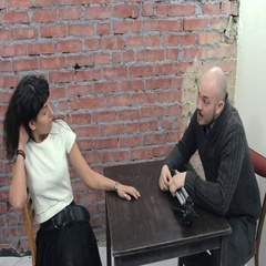 Man with tripod for camera sit at table and interviewing young woman. Flirtation Stock Footage