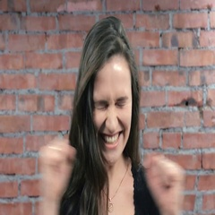 Young girl depict gladness, happy, air kiss in camera. Casting. Brick wall Stock Footage