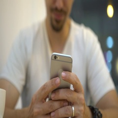 4K man caucasian using smartphone in coffeeshop to chat and contact people -Dan Stock Footage