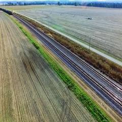 Kansas City, KS, Nov. 6, aerial pan of freight train traveling through farmland Stock Footage