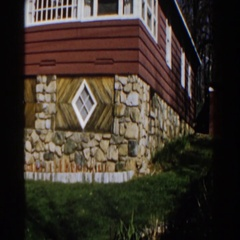 1959: panning of building with many different stones and bricks MICHIGAN Stock Footage