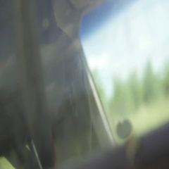 Abstract slow motion driving shot through back window of pickup truck, Stock Footage