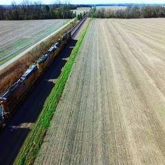 Kansas City, KS, Nov. 6, aerial view of freight train traveling through farmland Stock Footage