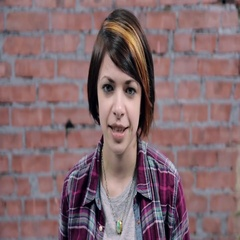 Young girl with colored short hair speak in camera, smile. Casting. Brick wall Stock Footage