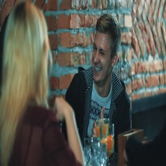 Friends talking at bar 4k video. Young man laughing at cafe table with beverage Stock Footage