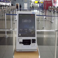 Carry on only screen at kiosk in JFK airport Stock Footage