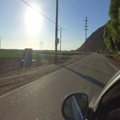 Front view of driving through suburban roads at moderate speed. Camera mounted Stock Footage
