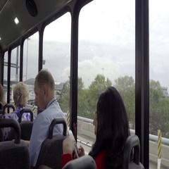 Woman on smartphone, flight attendant and pilot riding air bus interior Stock Footage