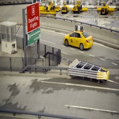 Taxi cab driving to airport at JFK - far shot Stock Footage