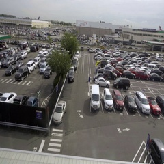 Aerial view of cars parked in outdoor parking lot at JFK airport Stock Footage