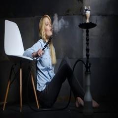 Beautiful young woman inhaling hookah. girl smoking shisha in cafe Stock Footage