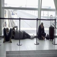 Travelers sleeping and lying on floor in JFK Airport Stock Footage