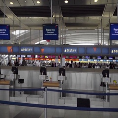 Delta Airlines kiosks and sign interior JFK Airport in New York Stock Footage