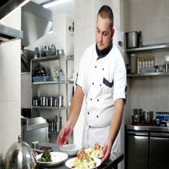 Portrait of a chef, cook checks dishes with salads, ready meals shows, looking Stock Footage