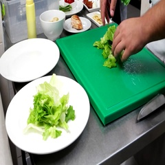 Lettuce, Salad leaves chef puts on a plate, professional-kitchen, the chef Stock Footage