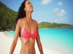 Mixed race woman smiling at the beach on tropical vacation Stock Footage