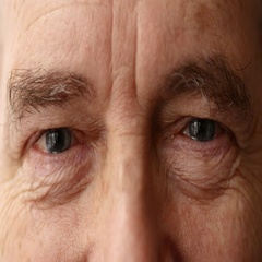 Senior Old Man Opens And Closes His Eyes, Close Up, White Background Stock Footage