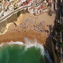 Aerial. Carvoeiro beach view from the sky, tourists on vacation. Portugal. Stock Footage
