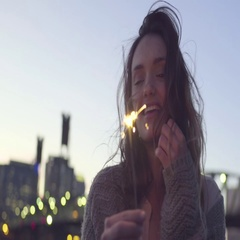 Closeup Of Happy Young Woman Dancing With Sparkler Stock Footage