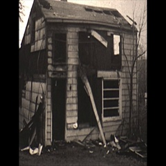 Vintage 16mm film, 1967, fire investigator interior post fire of small house Stock Footage