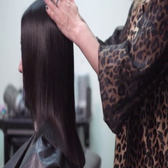 Hairdresser combing the hair in a beauty salon Stock Footage