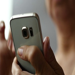 Elderly Woman Using Smartphone, White Background, Close Up Stock Footage