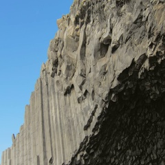 Bottom view on ceiling of basalt cave and large basalt columns on background of Stock Footage
