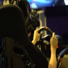 4K Asian Man Playing Video Games of Racing Car with ride simulator using VR -Dan Stock Footage