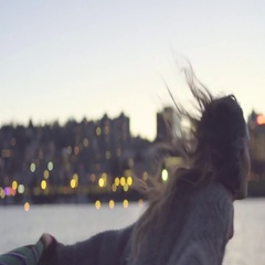 Young Woman Holds Blanket And Runs Past Camera To Dock, She Twirls In A Circle Stock Footage