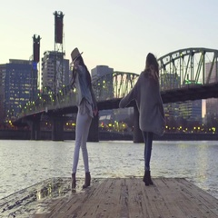 Excited Young Women Twirl And Dance Around Dock Stock Footage