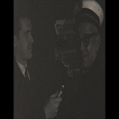 Vintage 16mm film, 1967, interview  with fire chief low light Stock Footage