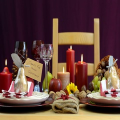Thanksgiving table with place settings and cornucopia centerpiece Stock Footage