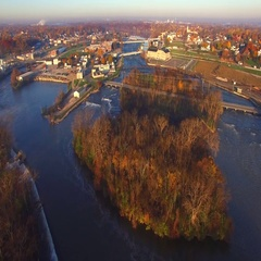 Colorful Autumn aerial flyover of scenic Kaukauna Wisconsin waterfront. Stock Footage