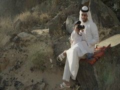 Arab man with son looking through binoculars. Stock Footage