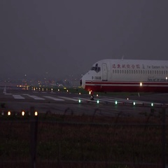 Slow motion Jet Airplane Prepares For Take Off From Airport in the night-Dan Stock Footage