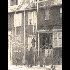 Vintage 16mm film, 1967, house fire, post, ladder and hose, winter Stock Footage