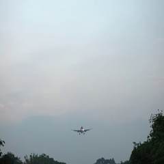 4K Commercial Passenger Aircraft Across Flying Over Head. Plane fly in day -Dan Stock Footage