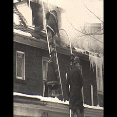 Vintage 16mm film, 1967, house fire with smoke, ladder against home, winter Stock Footage