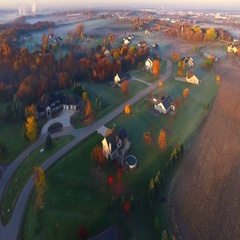 Colorful Wisconsin Autumn aerial flyover of scenic rural neighborhood Stock Footage