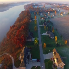 Colorful Autumn aerial flyover of scenic rural Wisconsin neighborhood Stock Footage