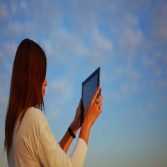 Beautiful girl photographing scapes on the tablet and chooses the best photo Stock Footage