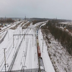 Freight, cargo train passing railroad station in winter. Aerial shoot Stock Footage