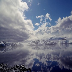 Clouds moving over frozen lake Stock Footage