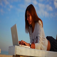 Young buisness woman working online lying on the bench  by the sea Stock Footage