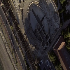 Aerial of traffic on elevated road and stadium under construction Stock Footage