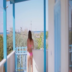 Female with blue cocktail opens the gate and goes down the stairs Stock Footage