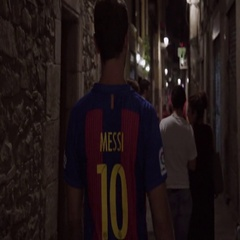 Rear view of a football fan walking through alley in Spain Stock Footage