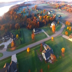 Colorful Autumn aerial flyover of scenic rural Wisconsin neighborhood. Stock Footage