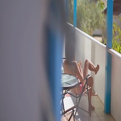Ladyl drinking a cocktail on the terrace, spying beyond the wall view Stock Footage