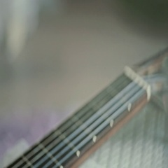 Classic guitar, close - up in slow motion Stock Footage